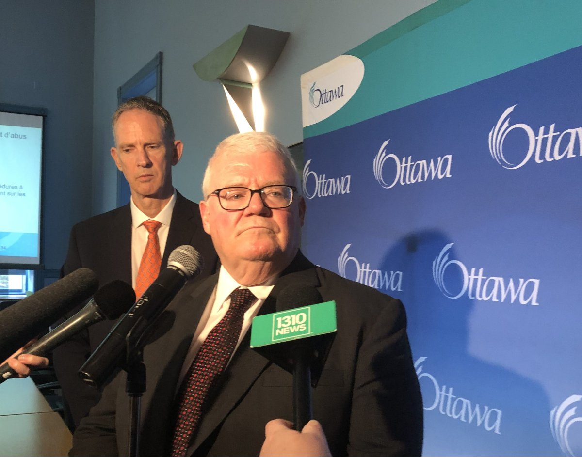 Ken Hughes, auditor general for the City of Ottawa, scrums with reporters at city hall on July 4, 2019, after tabling his annual report on cases reported to the municipality's fraud and waste hotline.