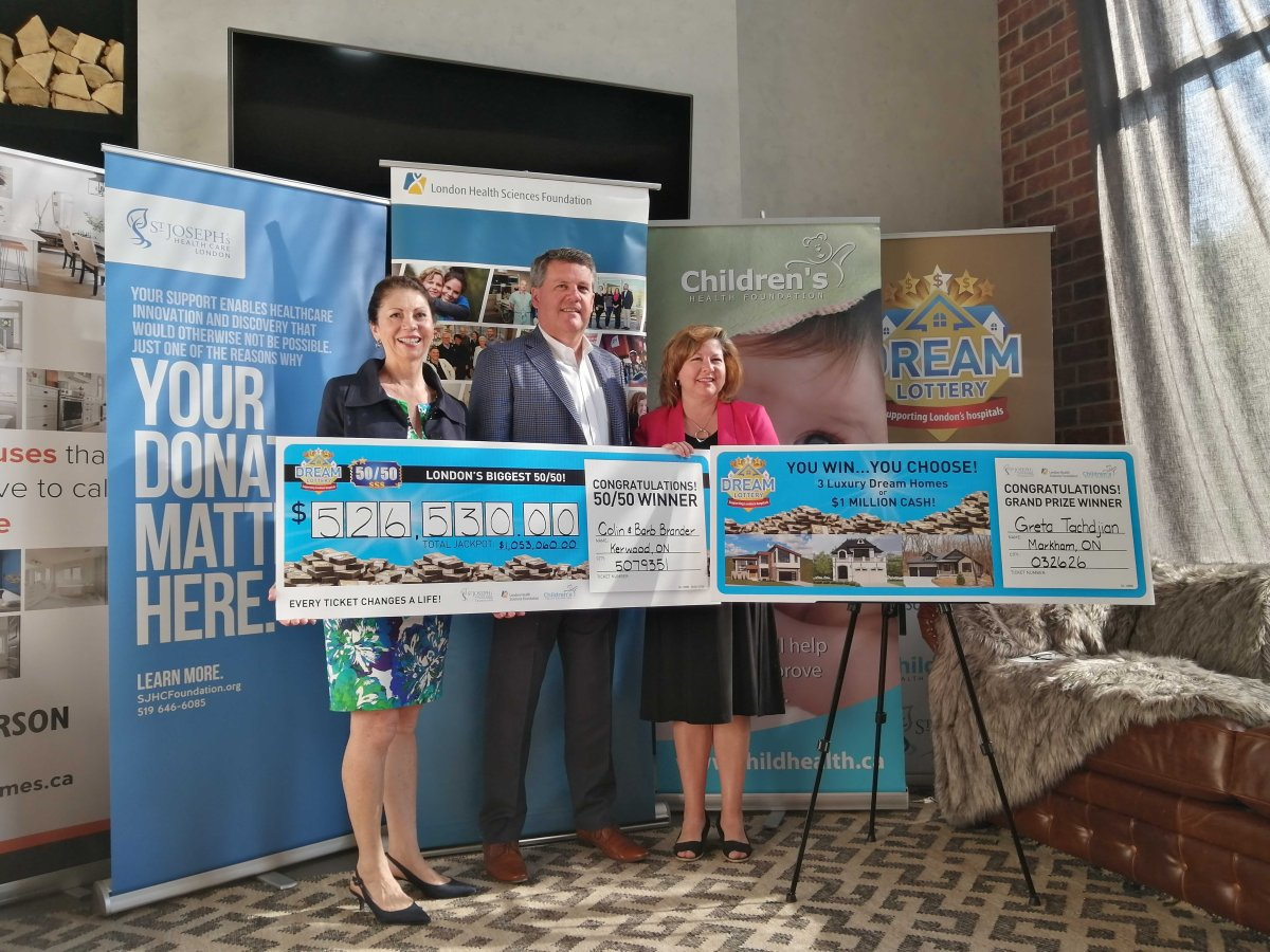 From the left: Elana Johnson, chair of the Children's Health Foundation, John MacFarlane, president and CEO of London Health Sciences Foundation and Michelle Campbell, president and CEO of St. Joseph's Health Care Foundation hold the cheques of the grand prize winner and 50-50 winner at the Jefferson Industrial Dream Home on  Thursday morning.