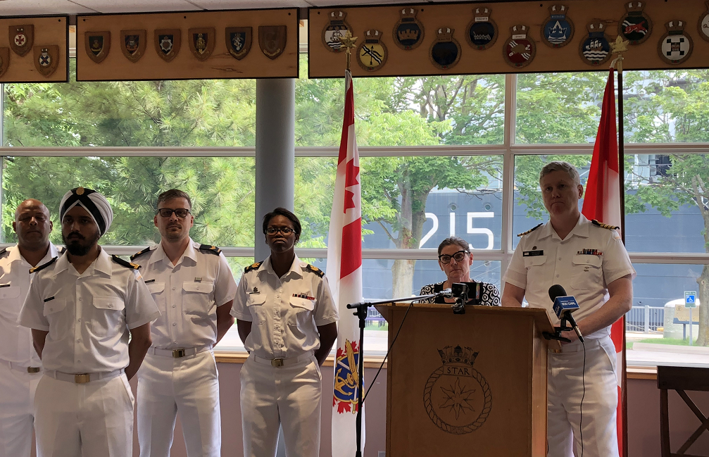 MP Filomena Tassi and Captain Tim O'Leary stand in front of HMCS Haida following Tassi's announcement on behalf of Minister of National Defence Harjit Sajjan.