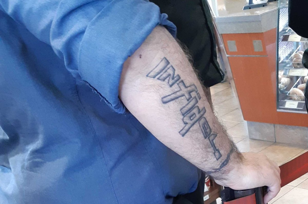 """The Canadian Armed Forces have confirmed that a sailor who had a tattoo of the word """"infidel"""" in the shape of a rifle has acknowledged concerns raised on social media."""