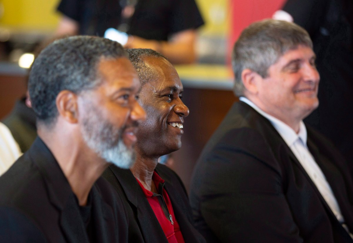 Former Winnipeg Blue Bomber defensive back, Less Browne, middle, smiles with fellow inductees, Damon Allen, left, and Dan Ferrone, right, during the official relaunch of the Canadian Football Hall of Fame (CFHOF) and Museum in 2018. Browne will be inducted into the Bomber's Hall of Fame this fall.