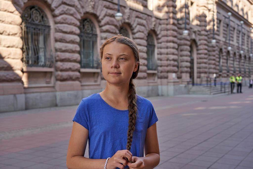 Greta Thunberg stands next to Swedish Parliament in Stockholm on July 26, 2019.