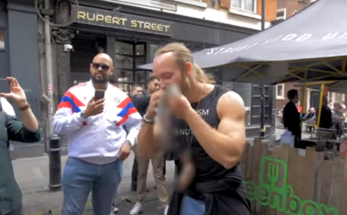 A pro-meat protesters ate raw squirrel at a vegan market in London.