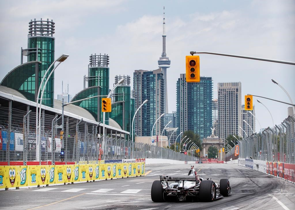 Simon Pagenaud of France drives on his way to winning first pole position during qualifying at the 2019 Honda Indy Toronto, in Toronto, Saturday, July 13, 2019. THE CANADIAN PRESS/Mark Blinch.