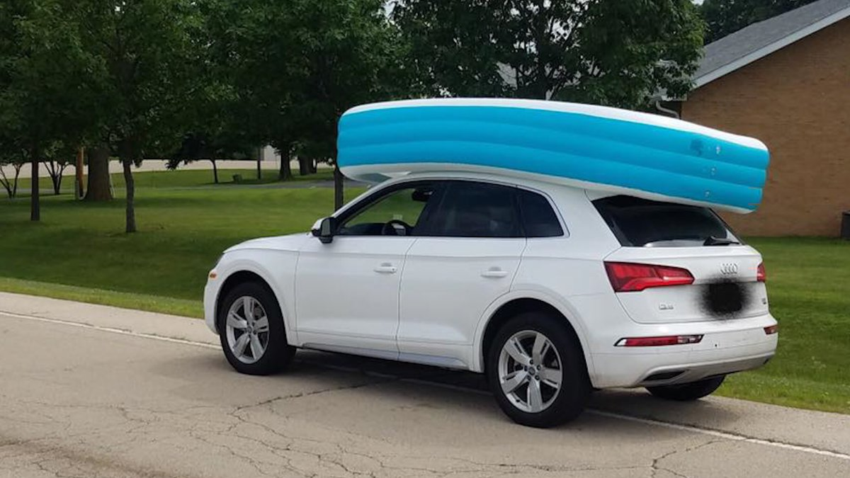 A photo provided by the Dixon Police Department shows a woman's car with an inflatable pool on top.