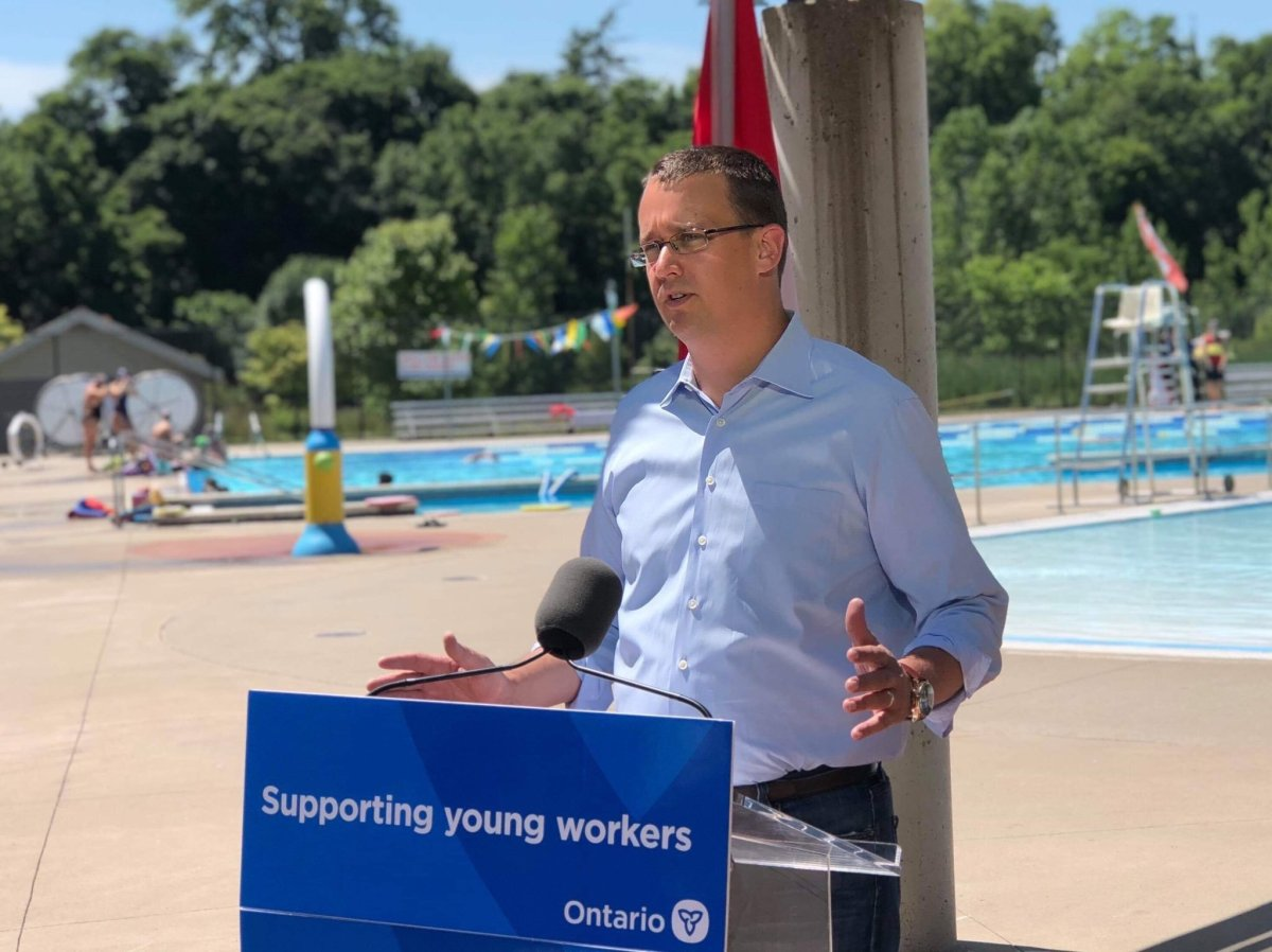 Ontario Labour Minister Monte McNaughton addresses reporters at the Thames Pool on Ridout Street in London, Ont.