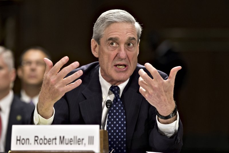 FILE - In this June 19, 2013, file photo, then-FBI Director Robert Mueller testifies on Capitol Hill in Washington. When special counsel Mueller testifies before Congress it will be a moment many have been waiting for, but it comes with risk for Democrats.