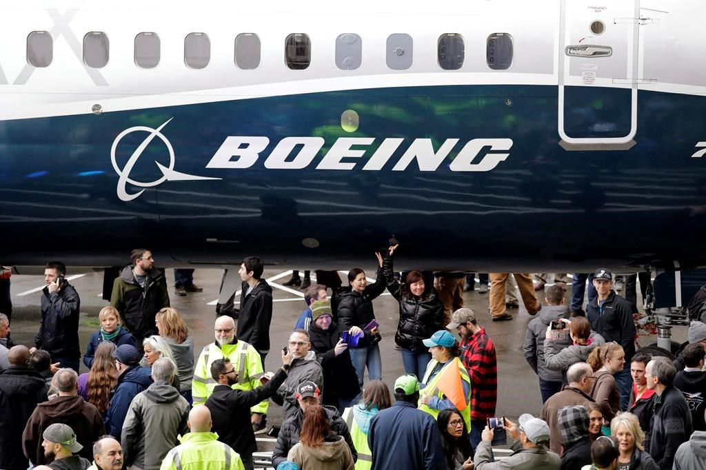 In this Feb. 5, 2018, file photo a Boeing 737 MAX 7 is displayed during a debut for employees and media of the new jet in Renton, Wash.