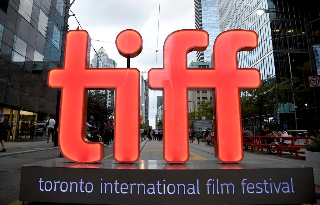 """FILE - In this Thursday, Sept. 6, 2018, file photo, a view of a festival sign appears on Day 1 of the Toronto International Film Festival in Toronto. TIFF organizers announced Tuesday, July 23, 2019, that the upcoming festival will include the premieres of the superhero film """"Joker,"""" a Mister Rogers biopic starring Tom Hanks and """"Hustlers,"""" a film about strippers scamming Wall Street bankers, with Jennifer Lopez and Cardi B. (Photo by Chris Pizzello/Invision/AP, File)."""