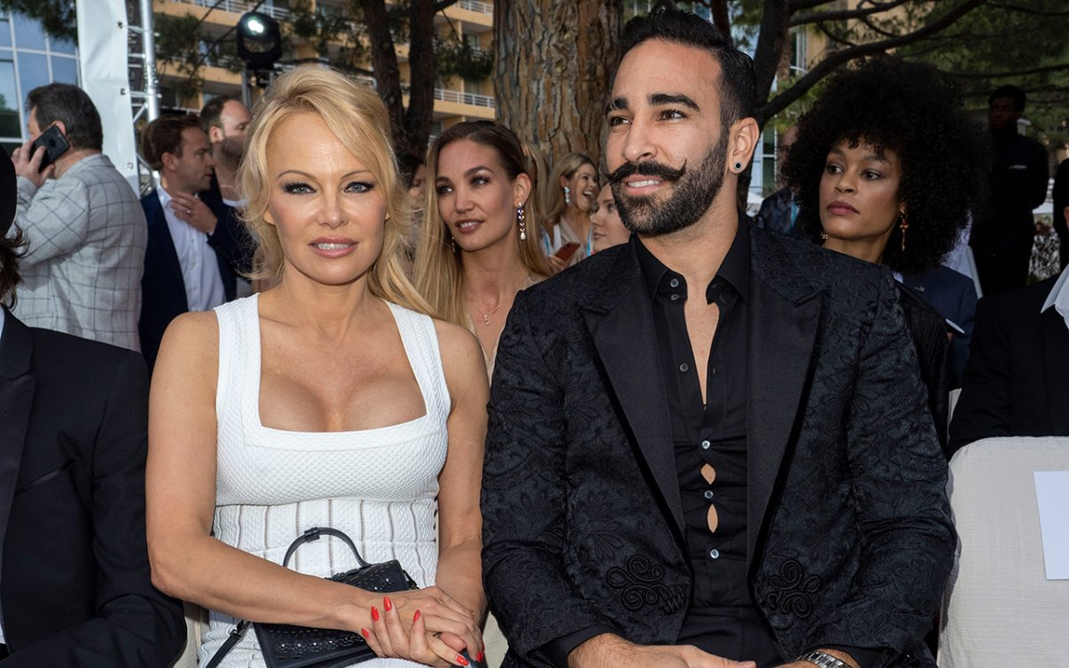 (L-R) Pamela Anderson and Adil Rami attend Amber Lounge 2019 Fashion Show on May 24, 2019 in Monte-Carlo, Monaco.
