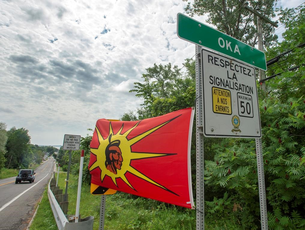 Mohawk flags are placed at the border of the Kanasatake Mohawk territory and the town of Oka Friday, July 19, 2019 in Oka, Quebec.