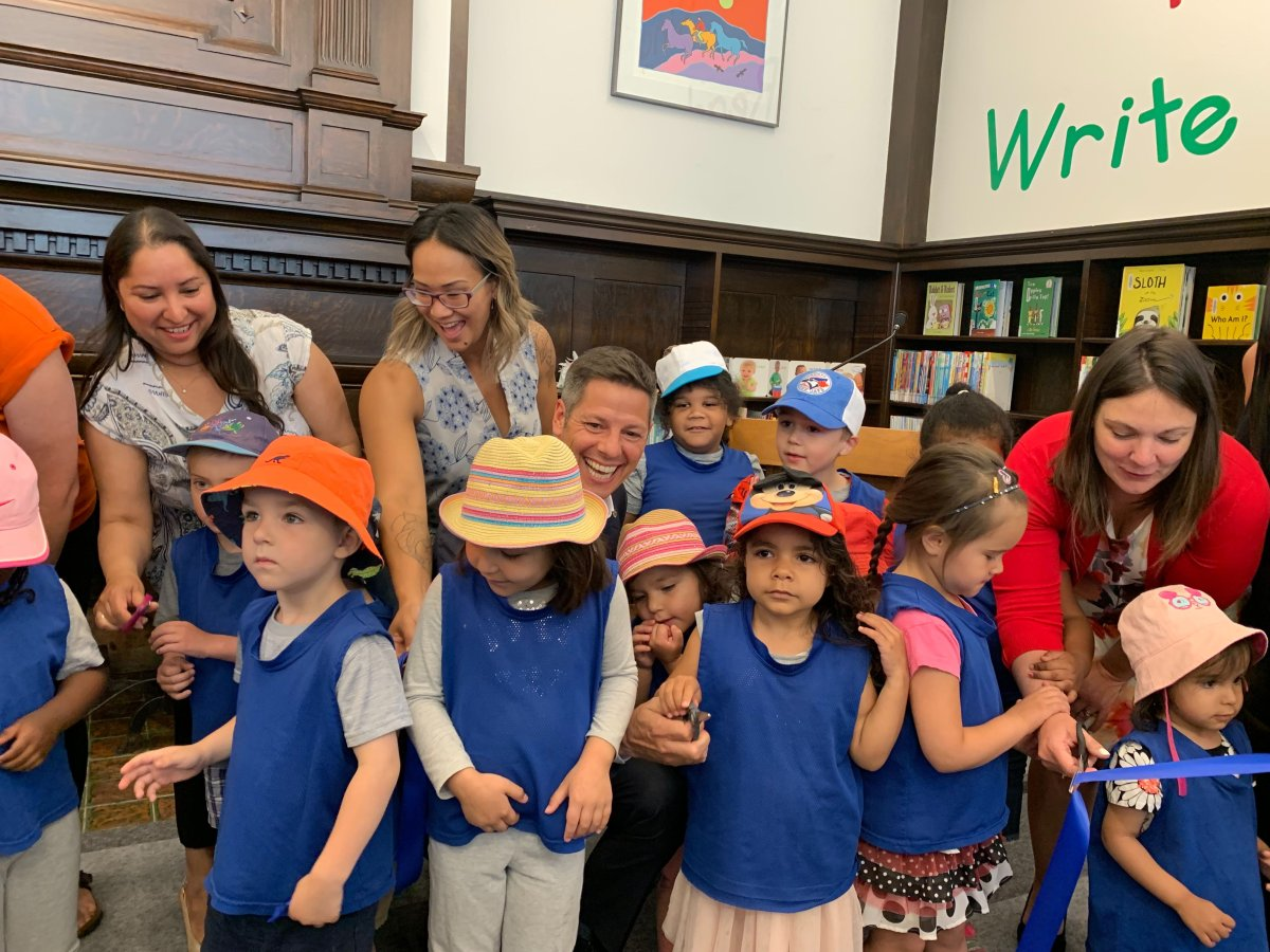 Winnipeg mayor Brian Bowman and colleagues from city hall share laughs with children at Friday's reopening of St. John's Library.