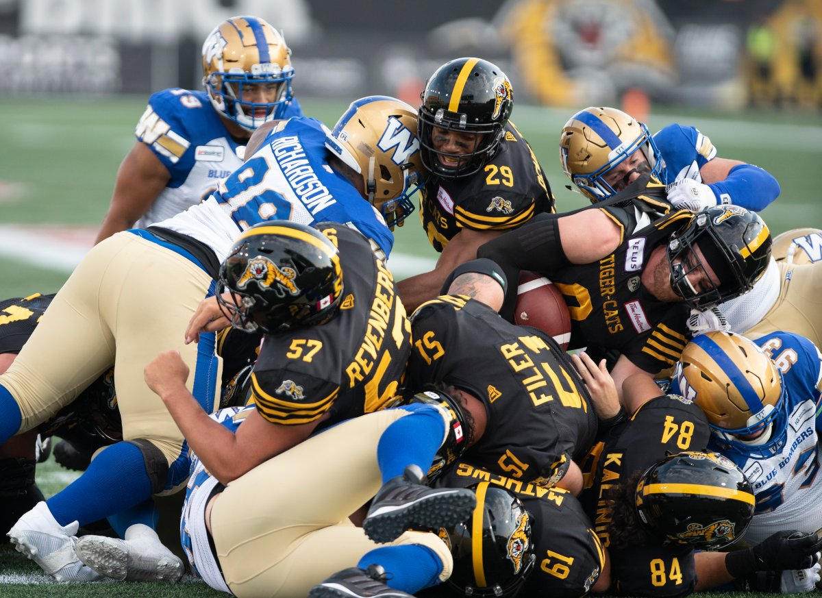 Hamilton Tiger-Cats quarterback Dane Evans (9) gets over the line for a TD against the Winnipeg Blue Bombers during first-half CFL football game action in Hamilton, Ont., on Friday, July 26, 2019.