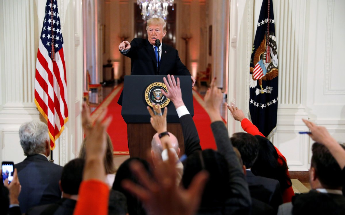 U.S.  President Donald Trump points to a questioner while taking questions during a news conference.