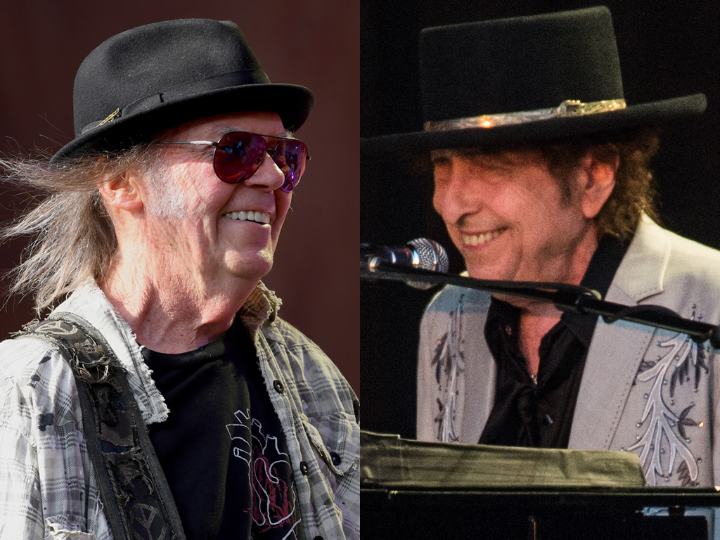 (L-R) Neil Young and Bob Dylan performing live in 2019.