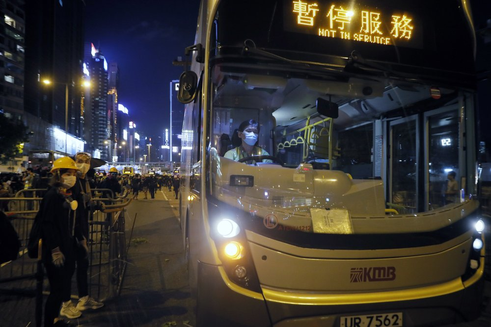 An off duty bus drives pass a barricades by protesters at Causeway Bay to hold the anti-extradition bill protest in Hong Kong, Sunday, Aug. 4, 2019.