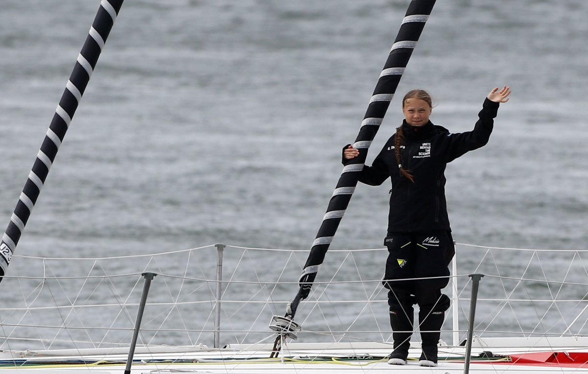 Swedish teenage climate activist Greta Thunberg waves from a yacht as she starts her trans-Atlantic boat trip to New York, in Plymouth, Britain, August 14, 2019.