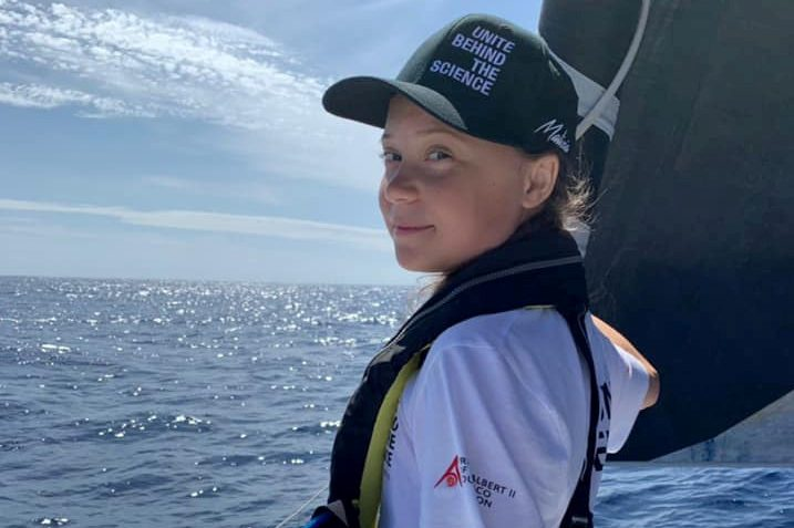 Swedish 16-year-old activist Greta Thunberg stands on the bow of the Malizia II racing yacht as she completes half of her trans-Atlantic crossing at sea August 20, 2019 in this picture obtained from social media. TEAM MALIZIA via REUTERS THIS IMAGE HAS BEEN SUPPLIED BY A THIRD PARTY. MANDATORY CREDIT. NO RESALES. NO ARCHIVES.