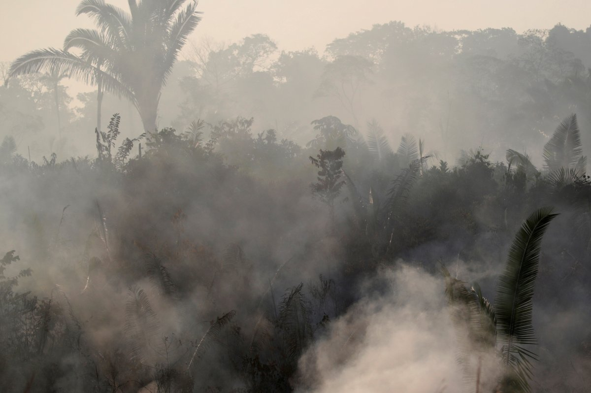 Smoke billows during a fire in an area of the Amazon rainforest near Humaita, Amazonas State, Brazil, Brazil August 14, 2019. Picture Taken August 14, 2019.