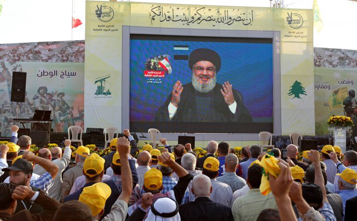 The leader of Hezbollah, one of the terror groups sponsored by Iran, addresses supporters via a screen, August 25, 2019.