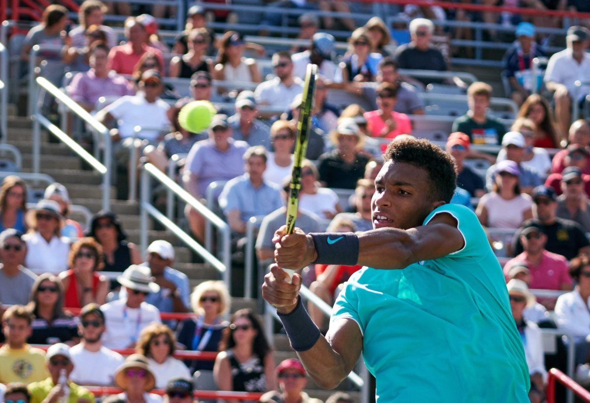 Félix Auger-Aliassime of Canada in action against Karen Khachanov of Russia during their round of 16 match at the Rogers Cup in Montreal, Canada, 08 August 2019.