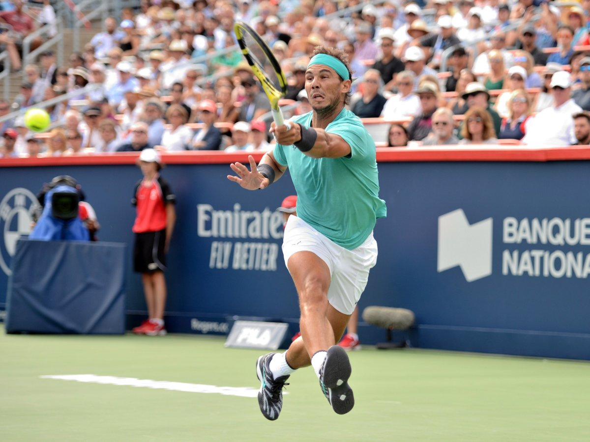 Spain's Rafael Nadal hits a shot against Russia's Daniil Medvedev during the final of the Rogers Cup tennis tournament in Montreal, Sunday, August 11, 2019.