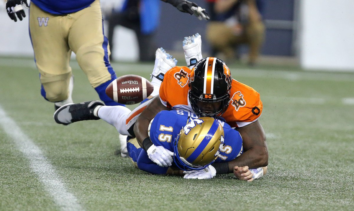 Winnipeg Blue Bombers QB Matt Nichols fumbles while taking a hit from B.C. Lions DL Shawn Lemon during fourth quarter CFL action in Winnipeg on Thursday, August 15, 2019.