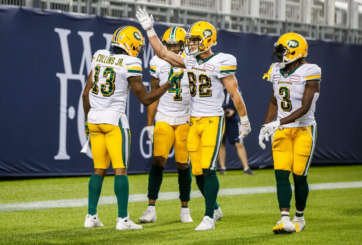 Edmonton Eskimos' Ricky Collins Jr. celebrates his touchdown with Greg Ellingson (82), against the Toronto Argonauts during the first half of CFL football action in Toronto, Friday August 16, 2019.