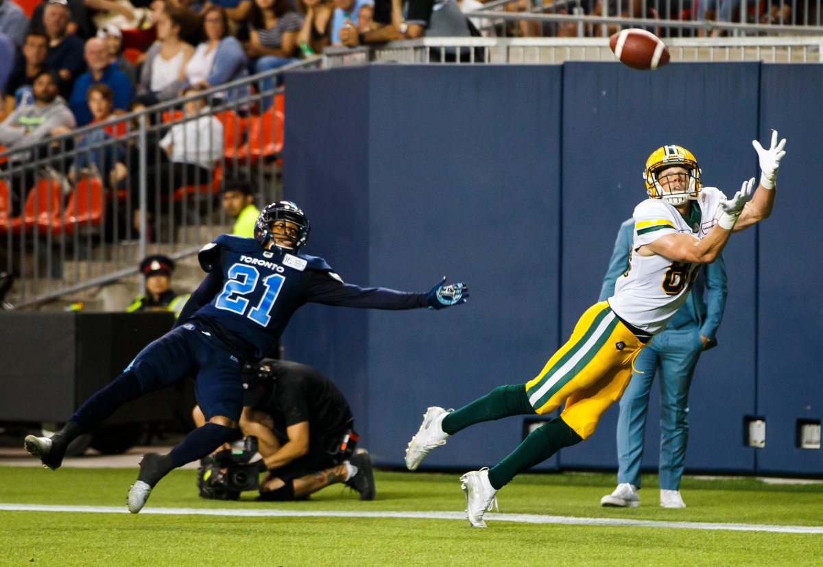 Edmonton Eskimos' Greg Ellingson makes a diving touchdown catch against Toronto Argonauts' Qudarius Ford during the second half of CFL football action in Toronto, Friday August 16, 2019.