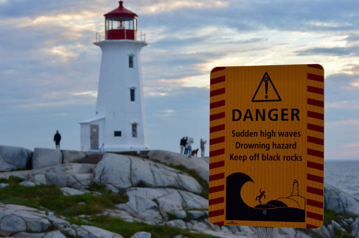 A sign warns visitors about the dangerous waves that can be found at Peggy's Cove in Nova Scotia.