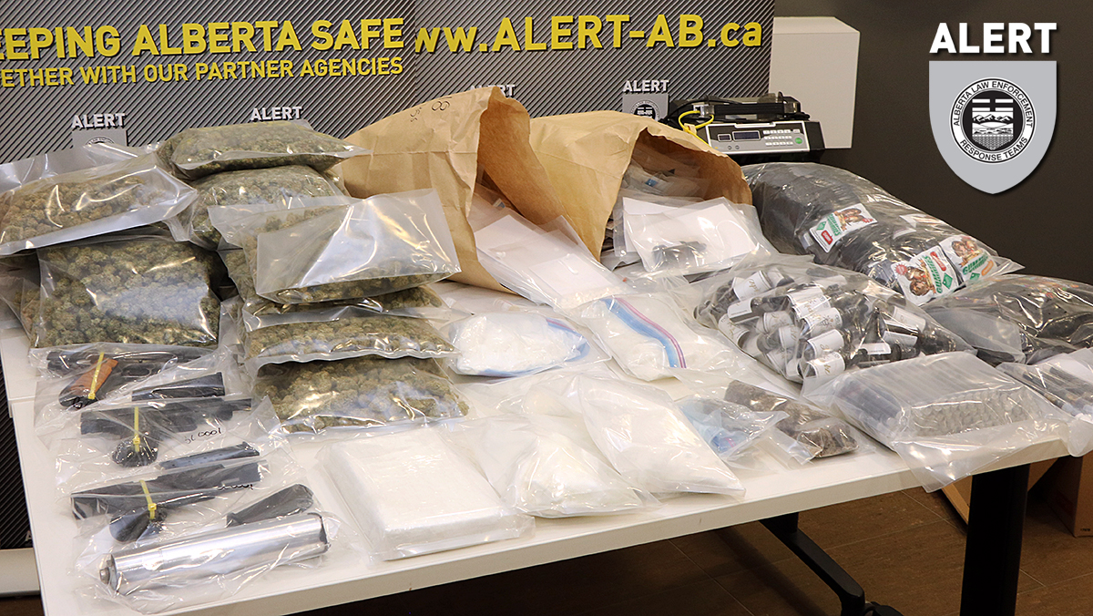Drugs and weapons seized by ALERT as part of an investigation into drug trafficking in Edmonton.