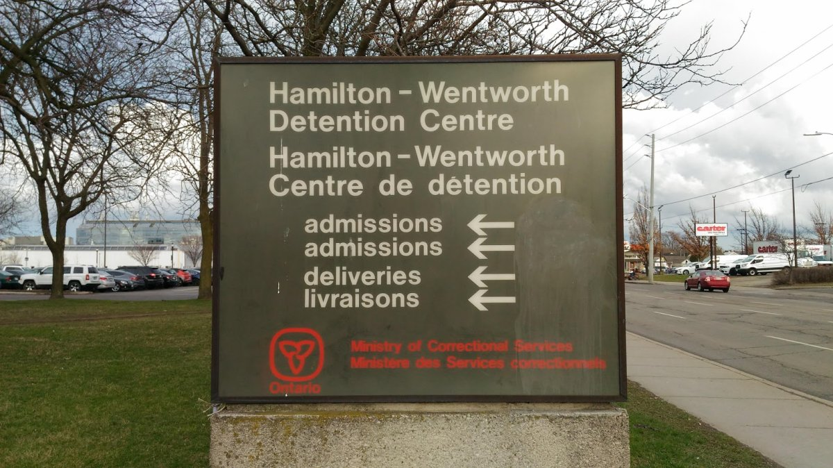 Two correctional officers charged and arrested by Hamilton Police .