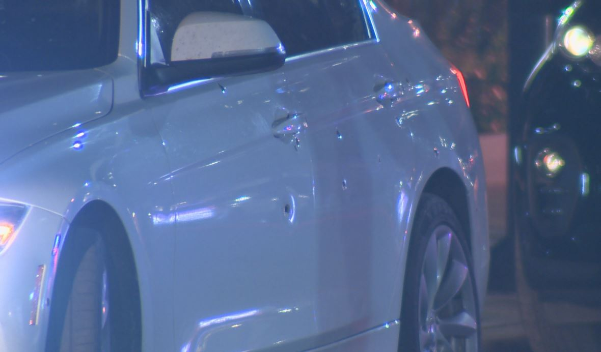 A car on Lombard Street could be seen with multiple bullet holes.