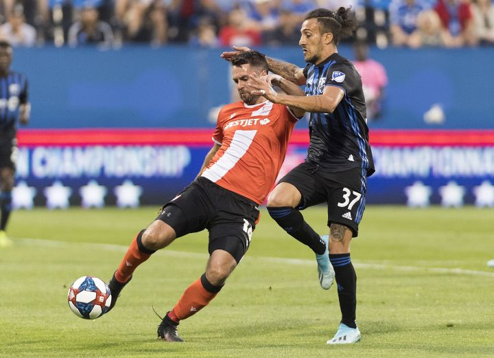 Montreal Impact's Maximiliano Urruti, right, challenges Cavalry FC's Jonathan Wheeldon during first half semifinal Canadian Championship soccer action in Montreal, on August 7, 2019. Cavalry FC, the Calgary-based CPL club, looks to defeat its second straight MLS team when it hosts the Montreal Impact on Wednesday in the second leg of their Canadian soccer championship semifinal.