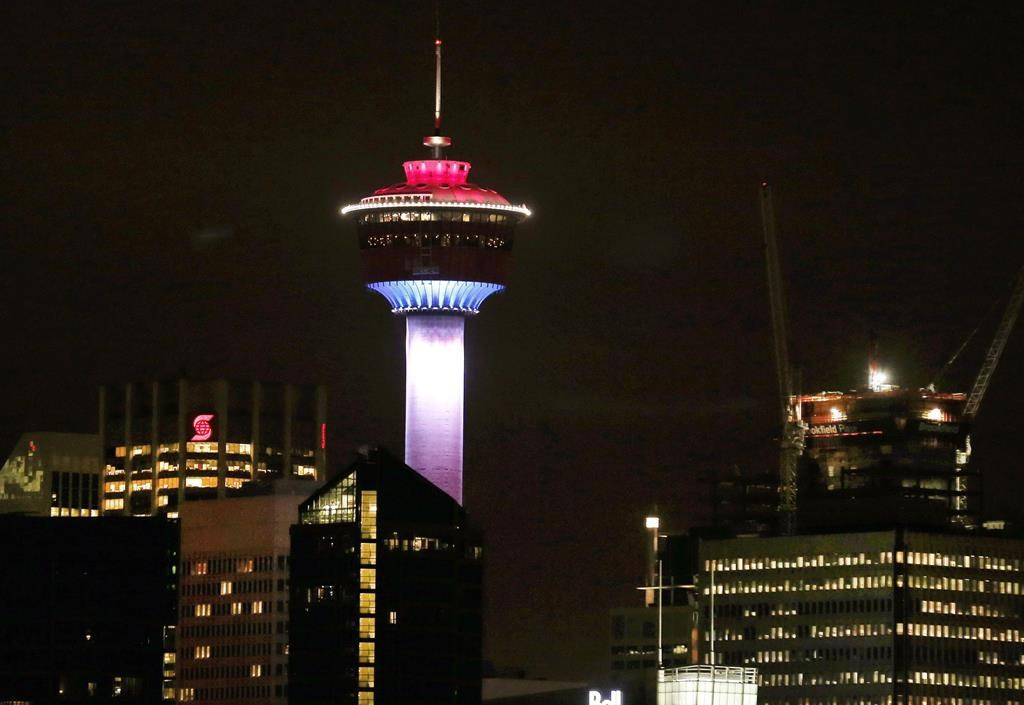 The Calgary Tower is lit up with the colors of the French flag to show support and sympathy regarding the Paris attacks in Calgary, Alta. on Friday, Nov. 13, 2015. One of Calgary's most recognizable landmarks remains closed seven weeks after an elevator with eight people on board plunged several floors.