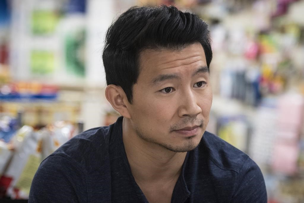 """Actor Simu Liu poses for a photograph on set during an interview in Toronto on July 24, 2019.Less than a month after landing the role of Marvel's first big screen Asian-American superhero, Chinese-Canadian actor Simu Liu is adding another major milestone to his resume: a book. HarperCollins says it plans to publish a memoir from the writer/actor/director, who is known for his role on the CBC-TV comedy series """"Kim's Convenience."""