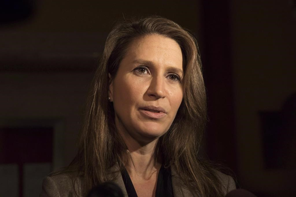 Ontario Francophone Affairs Minister Caroline Mulroney speaks to reporters following an early morning PC Caucus meeting at the Ontario Legislature in Toronto on Thursday, November 29, 2018.