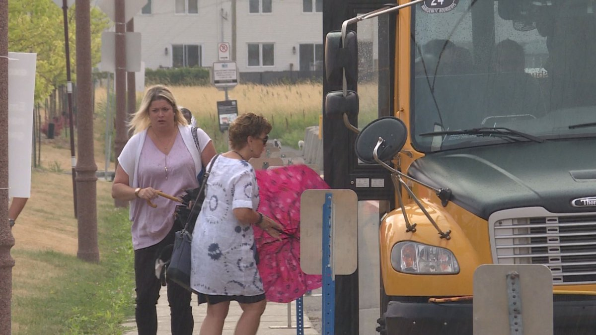 Riders hop onto the Shuttle bus at the Vaudreuil train station.