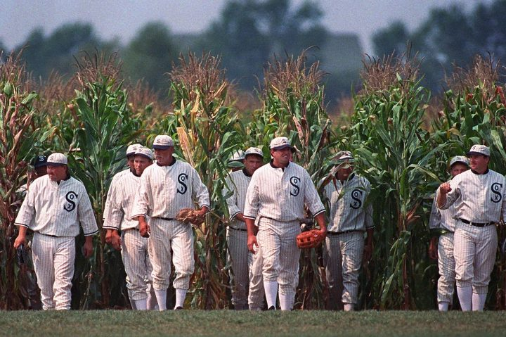 """In this July 22, 1997, file photo, people portraying ghost players emerge from a cornfield as they reenact a scene from the movie """"Field of Dreams"""" at the movie site in Dyersville, Iowa."""