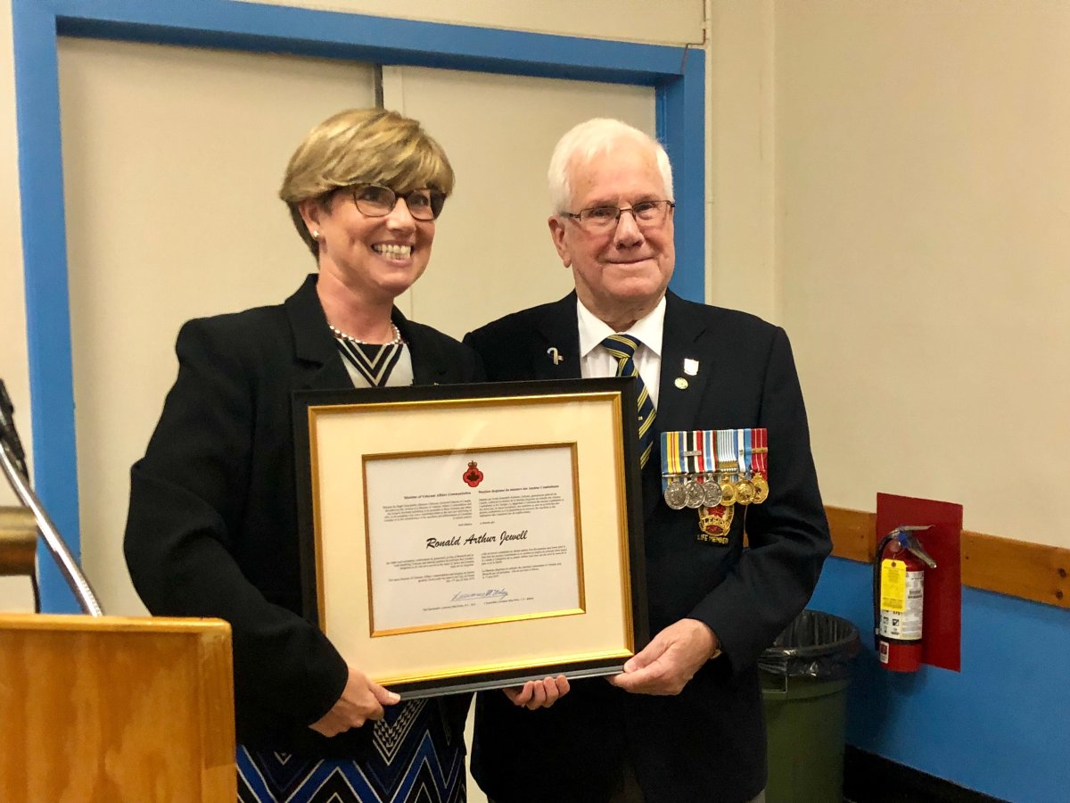 Karen Vecchio, Member of Parliament for Elgin-Middlesex-London, presenting Ronald Jewell with Minister of Vetrans the Affairs Commendation for his work with the Canadian Legion.