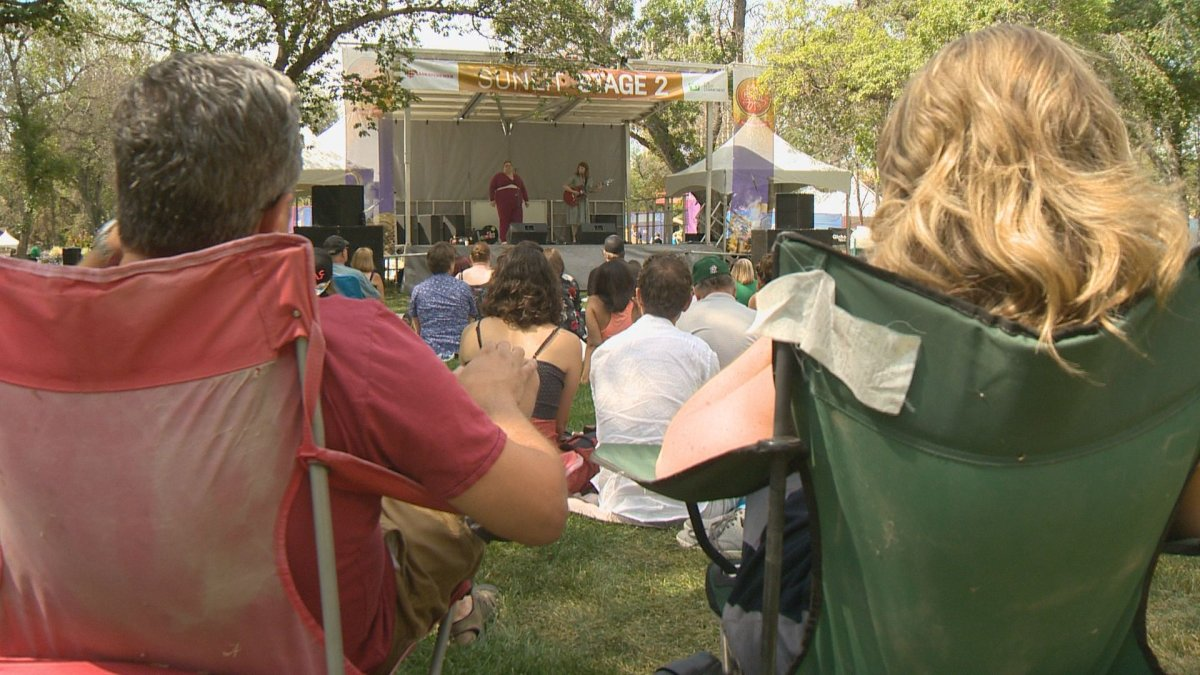 Regina Folk Fest attendees watch Megan and Jenna Nash perform on Friday afternoon.