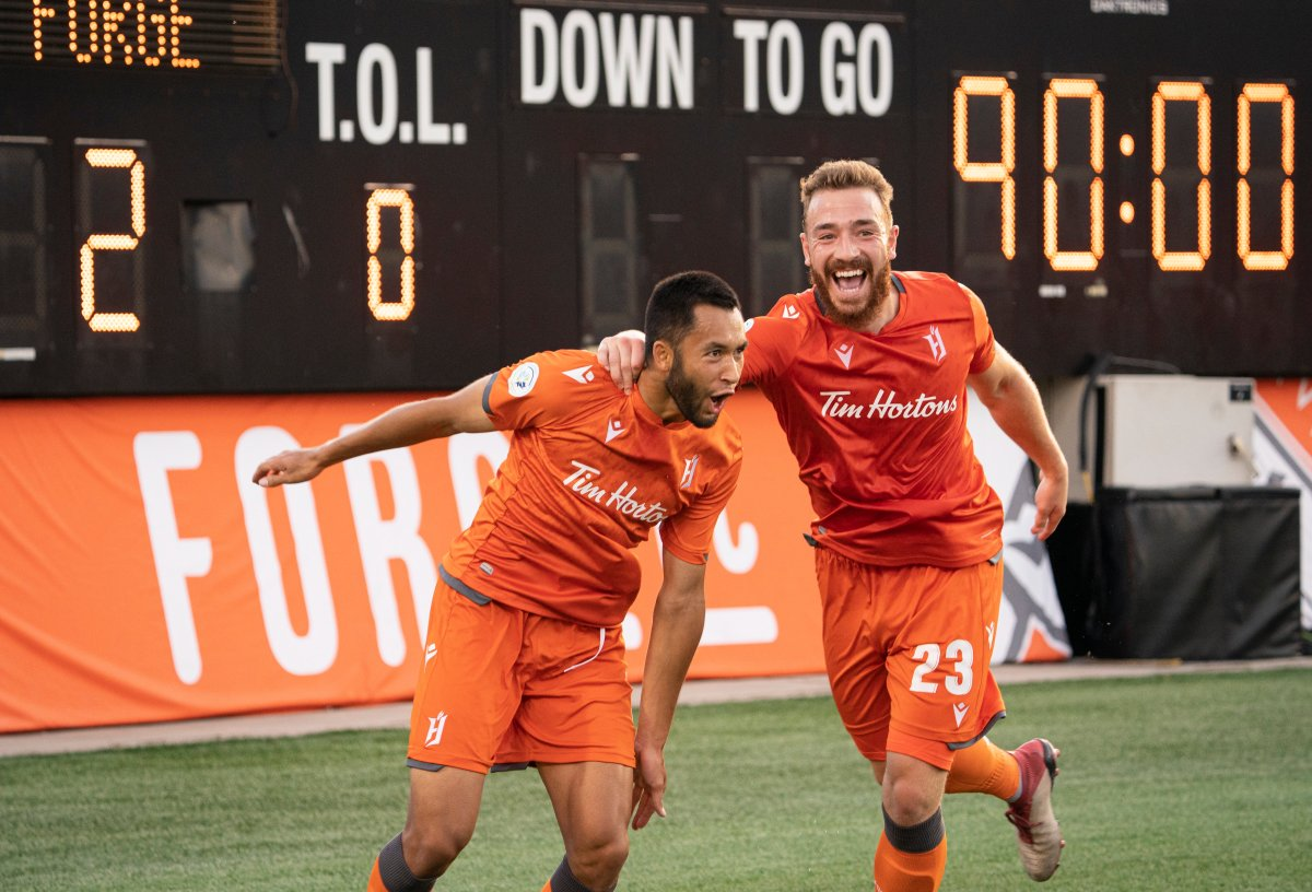 Hamilton Forge FC's David Choiniere (7) celebrates his game-winning goal with teammate Anthony Novak (23) during second-half Scotiabank CONCACAF League soccer action against Antigua Guatemala FC, in Hamilton, Ont., Thursday, Aug. 1, 2019.
