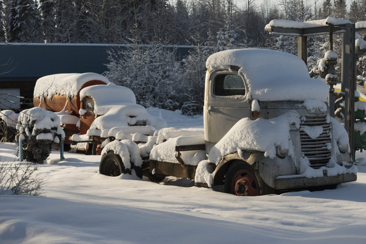Snow covered vehicles, Fort Nelson, British Columbia, Canada, on Wednesday, January 20, 2016.
