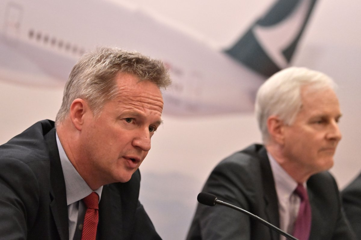Cathay Pacific's chief executive officer Rupert Hogg (L) speaks next to chairman John Slosar during a press conference following the release of the company's annual results in Hong Kong on March 13, 2019.
