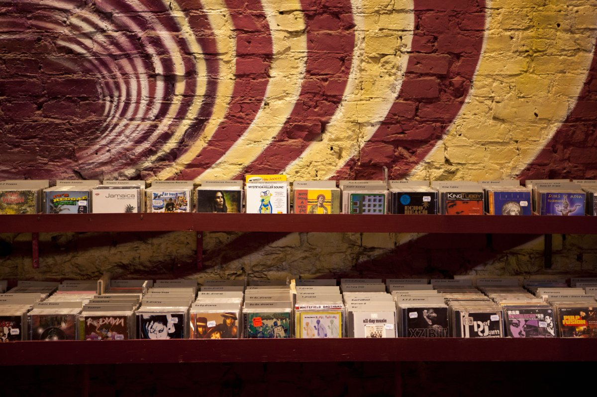 Shelves of compact discs in a record shop.