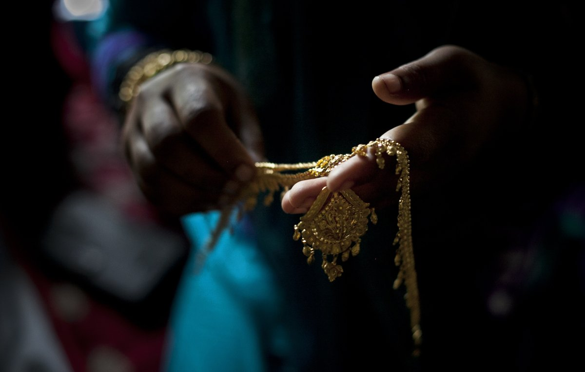 Gold wedding jewelry is laid out for a wedding on August 20, 2015 in Manikganj, Bangladesh.
