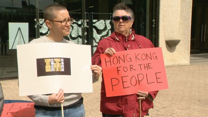 A group gathered outside Regina City Hall Saturday to voice solidarity with those protesting in Hong Kong.