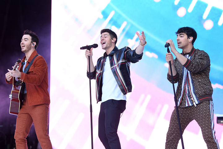 File photo of the Jonas Brothers performing in concert. The group's Friday night show in Toronto ended early, leaving many fans confused.