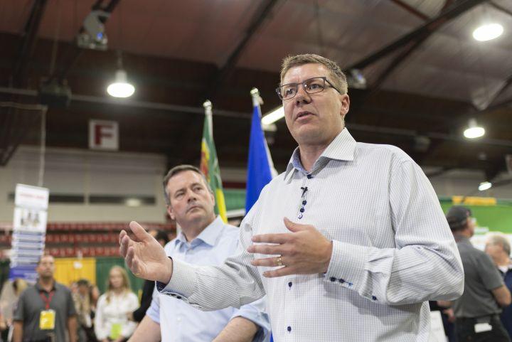 Alberta Premier Jason Kenney, left, and Saskatchewan Premier Scott Moe, right, speak during a press conference at the Saskatchewan Oil & Gas Show in Weyburn, Sask. on Wednesday June 5, 2019.