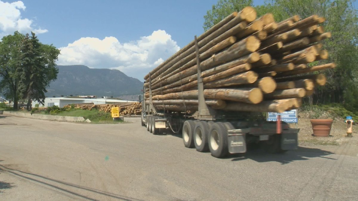 Logs are hauled into the Tolko mill in Kelowna.